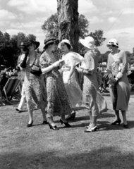Women wearing the latest summer fashions
