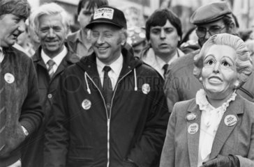 Arthur Scargill with NUM supporter wearing Thatcher mask  Stoke  1984.
