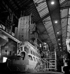 A man operates huge vertical borer  English Electric  Preston. 1955.
