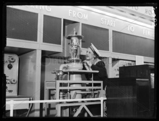 Woman with Marconi transmitting valve  Radiolympia  London  1936.