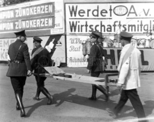 Carrying a stretcher at the AVUS race track  Berlin  1932.