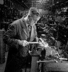 Worker at bench  JA Prestwick Ltd  motors Leeds 1953.