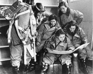 Women pilots reading a map  10 January 1940