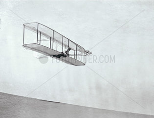 The Wright Brothers' modified third glider in flight  1902.