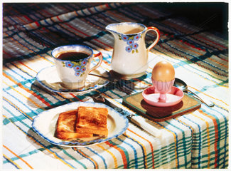 A table laid for breakfast  c 1930s.