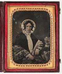Woman in a bonnet  c 1850.