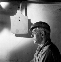 A portrait of Maltster with spade  Linkwood distillery  Elgin  1964.