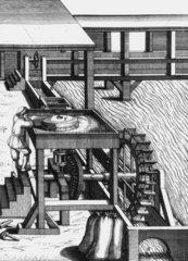 Corn mill driven by undershot water wheels  c 1662.