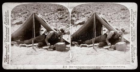 'British Field Telegrapher sending news of victory at Klip Drift  South Africa'  1900.