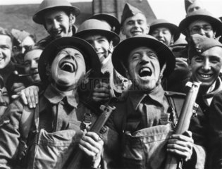 British soldiers laughing during an open air concert  c 1942.
