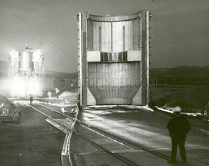 Nuclear rocket engine being transported to test stand  Nevada  1 Dec 1967.
