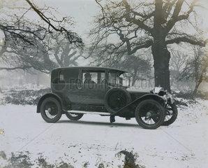 2 door Napier 6 cylinder saloon in snow scene