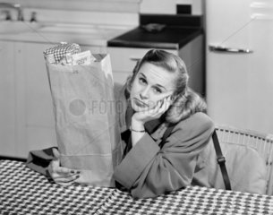 Woman with a bag of groceries  1952.