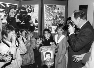 Neil Kinnock and children taking photographs  May 1987.