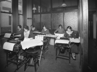 Great Western Railway office workers using calculating machines  1935.