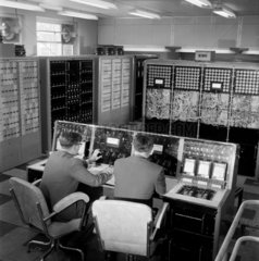 Two engineers at console of Mars computer  English Electric 1959.