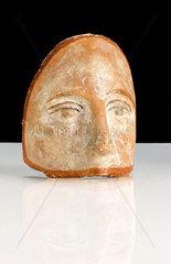 Votive terracotta face  probably Roman  200 BC-200 AD.