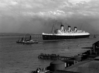 Cunard's White Star liner 'Queen Mary' under tow on the river Clyde  1936.