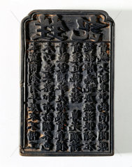 Japanese wooden printing block with oriental characters.