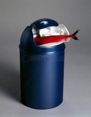 Plastic dustbin stuffed with plastic fish  1998.