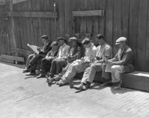 Construction workers relaxing  London  16 June 1932.