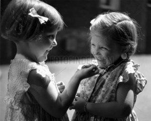 Girls with cherries  c 1930s.