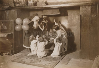 Father Christmas and children round a fireplace  3 December 1932.