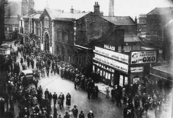 Audience leaving the Palace cinema  Wigan  Lancashire  c 1936.