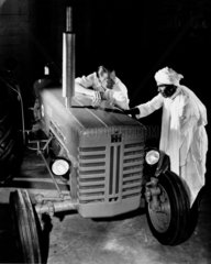 A farmer contemplates the purchase of a tractor  Guyana  1958.
