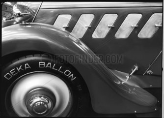 Detail of front wheel of a motor car with Deka Ballon tyre  c 1934.