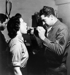 WAAF having her mouth inspected  15 Decembe