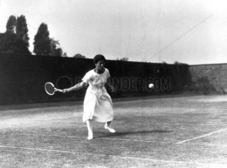 Woman tennis player about to play a shot  c