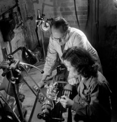 Female lens maker in training  Taylor Hobson  1953.