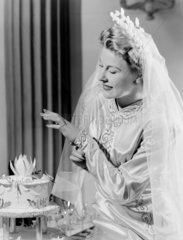 Smiling bride looking at her wedding ring  c 1948.