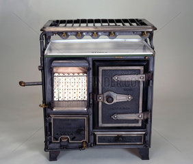 'Stimex' combination gas cooking range  fire and water circulator  c 1922.