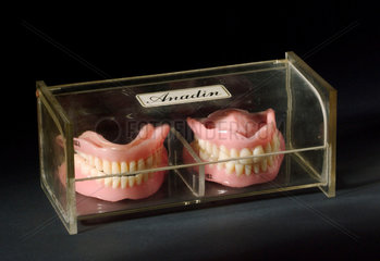 Upper and lower denture set and two odd full lower sets  1955-1965.