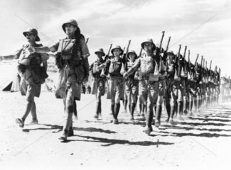 Newly arrived troops leaving their camp for a route march  19 November 1940.