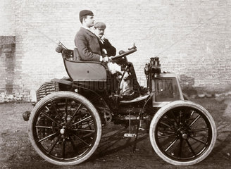 C S Rolls sitting in the first car in Britain fitted with wheel steering  1898.