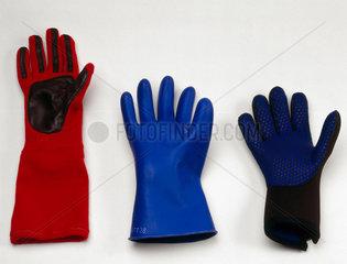 Three protective gloves  c 1982-1996.