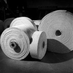 Pack shot of rolls of woven asbestos material at Turner Asbestos  Wigan.