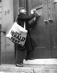 Newspaper boy delivering the 'Daily Herald'  13 December 1935.