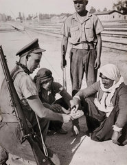 British soldiers sharing rations with prisoners  Jerusalem  1938.