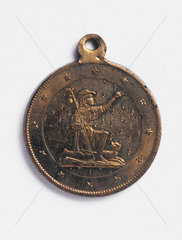 Brass amulet designed to protect against cholera  French  1820-1880.