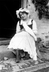 Woman wearing the latest fashions sitting o