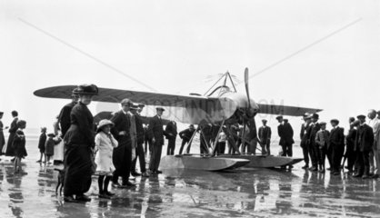 Seaplane surrounded by crowd  c 1930s.