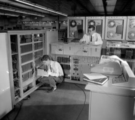 Engineers at Elliot Automation check computers in the assembly area  1966.