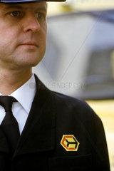 British Rail employee wearing uniform with Railfrieght MS  April 1964.