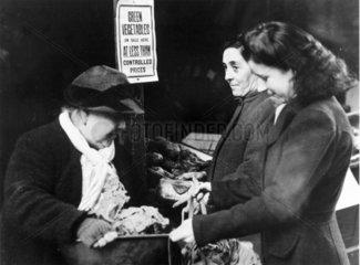 Women shopping for vegetables  13 January 1943.