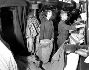 Workers sorting out the mail for the night postal train  London  26 November 1931.