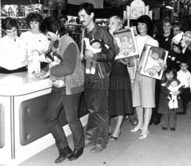 Shoppers queue to 'adopt' Cabbage Patch Kids  November 1983.